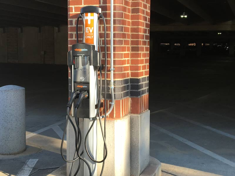 A mounted electric car charging station.